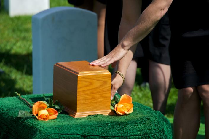 [Image: Memorial services can also be used as a way to say goodbye to a loved one who has chosen cremation over the traditional funeral service.]