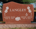 Pence Monument Company works with its customers to create an unlimited variety of memorials. This granite upright monument is an example of an option for a double monument with roses and the rings of marriage.