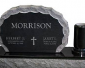 This is an example of a smaller option for a double upright monument with a single vase made from a granite base and jet black material.