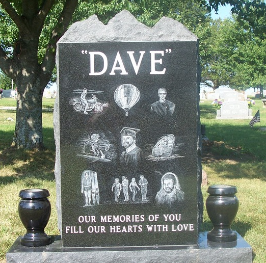 [Image: This granite monument is an example of a single upright monument with matching double vases and highlights the special moments in this man's life. Bring in your photos and let our artist customize your purchase. ]